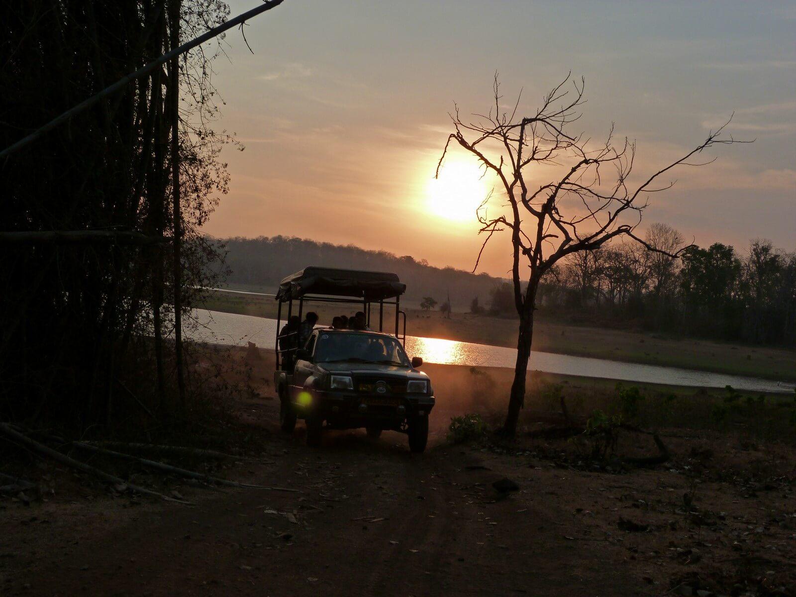 Safari Jeep against the sunset